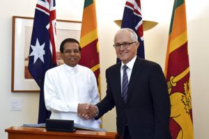 Sri Lanka's President Maithripala Sirisena, left, and Australia's Prime Minister Malcolm Turnbull smile at photographers as they meet at Parliament House in Canberra, Thursday, May 25, 2017. Sirisena's visit to Australia marks the 70th anniversary of diplomatic relations between the countries. (Mick Tsikas/AAP Image via AP)